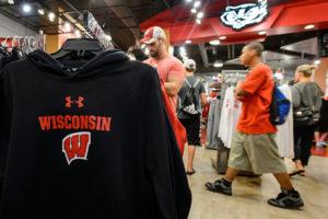 Badger fans shop for new apparel at Bucky's Locker Room inside Camp Randall.